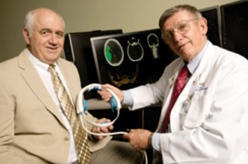 Image: UAMS researcher William Culp, MD, (right), and Doug Wilson of UALR (left) have developed a device to treat stroke (Photo courtesy of UAMS/UALR Office of Communications).