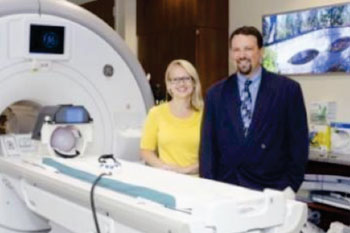 Image: Rachel Jacobs, UIC research assistant professor in psychiatry, and Scott Langenecker, UIC associate professor of psychiatry and psychology, use functional magnetic resonance imaging to examine the brain connectivity of young adults (Photo courtesy of Joshua Clark/UIC Photo Services).