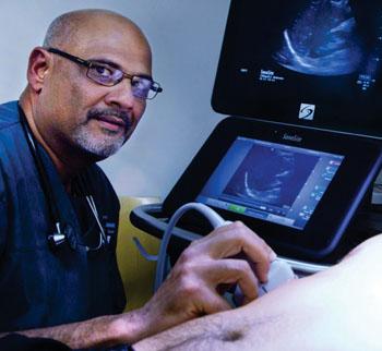 Image: Rip Gangahar alongside the Sonosite X-Porte ultrasound system (Photo courtesy of Fujifilm Sonosite).