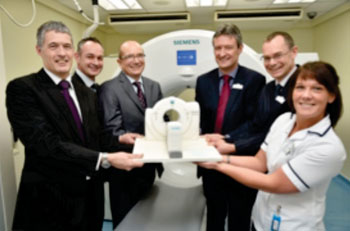 Image: Cobalt marks the installation of a Biograph mCT Flow EdgeTM system from Siemens Healthcare that will bolster its cancer and dementia diagnostic capabilities with a replica cake. (Photo courtesy of Siemens Healthcare).