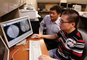 Image: Wei Qian, PhD and doctoral student Wenqing Sun Creating a Breast Cancer Prediction System (Photo courtesy of J.R. Hernandez/UTEP News Service).