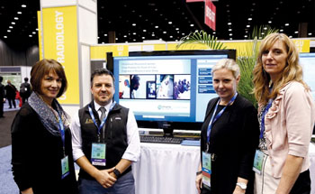 Image: Researchers Betsy L. Sussman, MD, Matthew D. LeComte, PhD, Kristen K. DeStigter, MD, and Mary Streeter, R.T. presenting a new obstetrical ultrasound technique for resource-poor areas (Photo courtesy of RSNA).